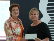 Minister Schryer presents cheque to Muriel McQueen Fergusson Foundation