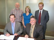 Provincial government, industrial training and certification officers sign new contract