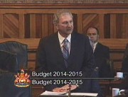 2014-15 budget freezing taxes, reducing deficit, making strategic investments